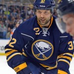Apologetic and emotional over head hit, Sabres tough guy John Scott says he belongs in NHL