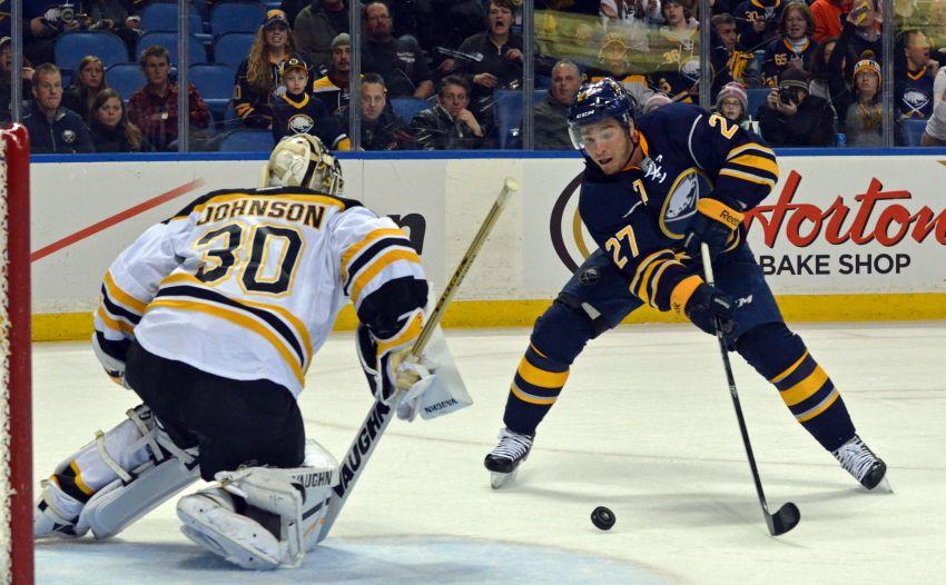 Late-game heroics help Sabres down Bruins, earn goalie Jhonas Enroth rare win